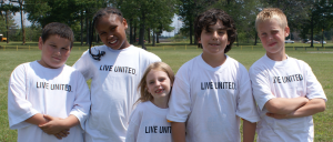 Kids standing together wearing United shirts